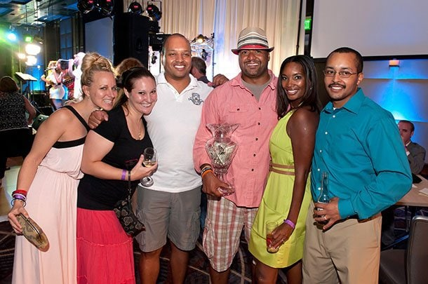 Former Raven linebacker Brad Jackson poses with a group of attendees.